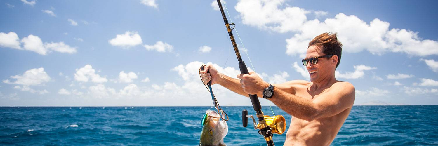 Guest fishing on a boat in Lizard Island