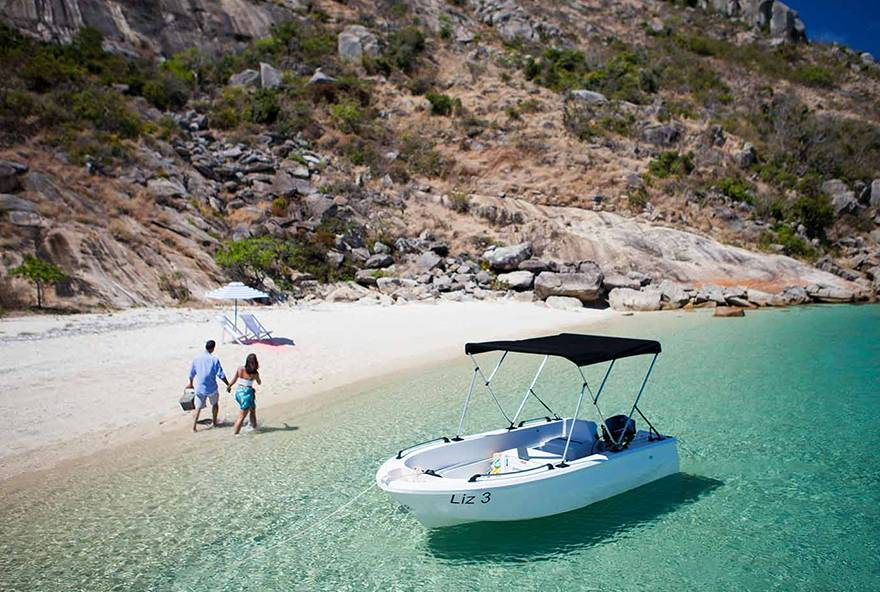 Take a motorised dinghy to explore one of Lizard Island's many secluded beaches for the day.