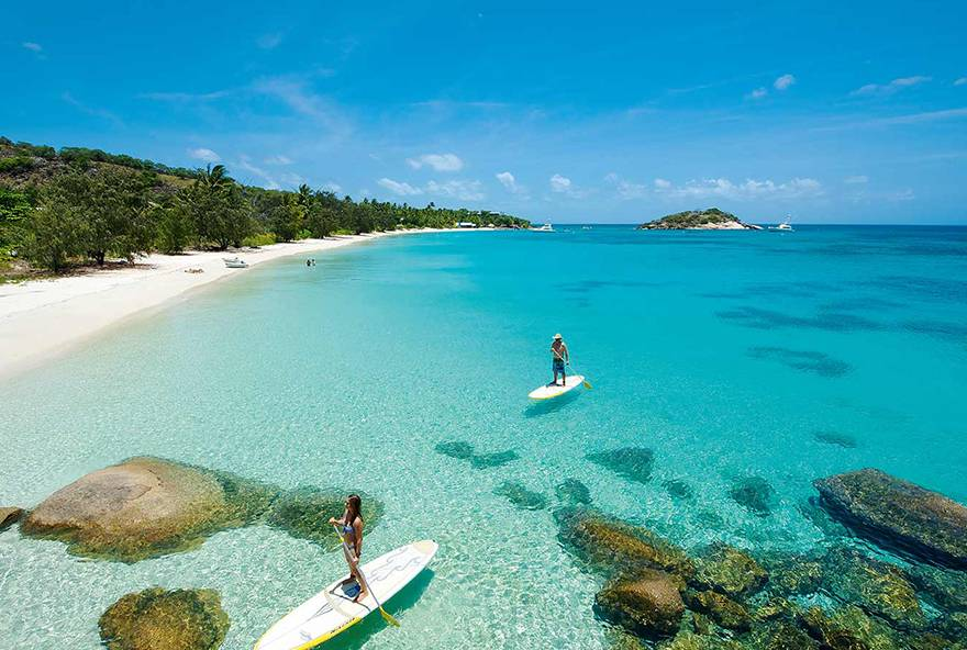 Enjoy a resort activity like stand up paddleboarding off one of Lizard Island's beautiful beaches.